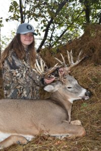 Girl with buck whitetail buck and Oregon hat